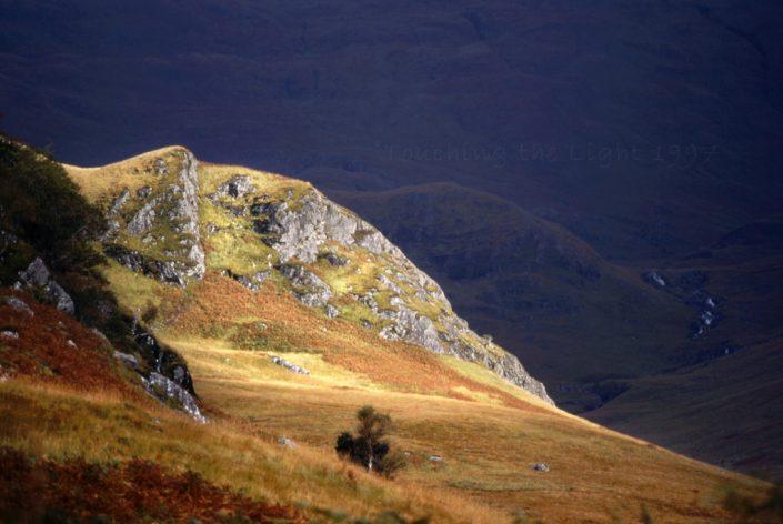 Sunlit crag, Gleann an Dubh Lochain, Knoydart, Scottish Highlands