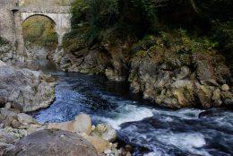 Pont du Diable, the Devil's Bridge, over the river Ariège near Foix, Ariège, France - Image by Touching the Light